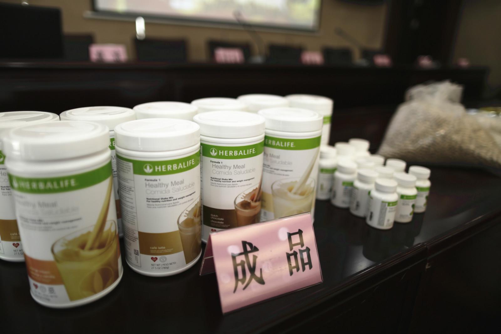 资料图片:苏州警方查获的假冒康宝莱保健品_meitu_2